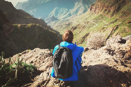 tourist looking at scenic view in mountains