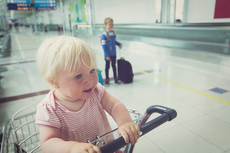 family with kids travel in airport Stock Photo