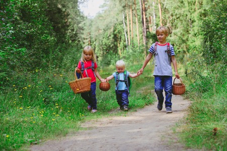 little boy with two girls going to forest