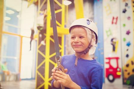 little boy enjoy sport climbing