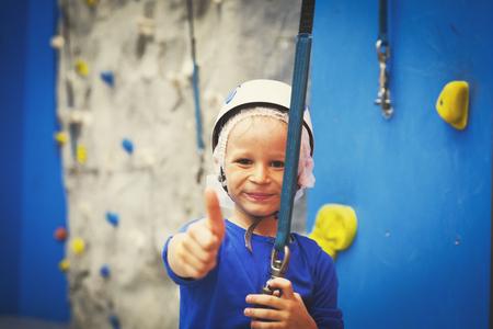 little boy loves sport climbing