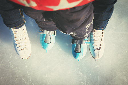 mother and child skating together in winter Stock Photo
