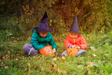 kids in halloween costume play at autumn, trick or treating Stock Photo