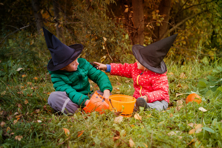 little boy and girl get ready for halloween party, trick or treating Stock Photo