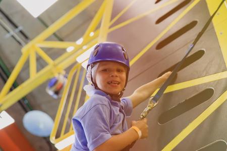 little boy learn sport climbing Stock Photo