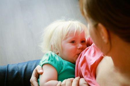 mother breastfeeding little baby daughter Stock Photo - 86902699