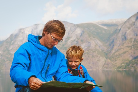 father and son travel hiking in mountains of Norway Stock Photo