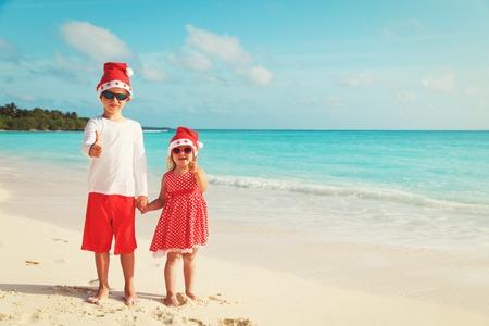 kids celebrating christmas on tropical beach