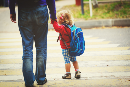 father and little daughter go to school or daycare Stock Photo