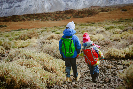 little boy and girl hiking in mountains 版權商用圖片