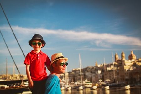 father and son playing on quay of Valetta, Malta 版權商用圖片