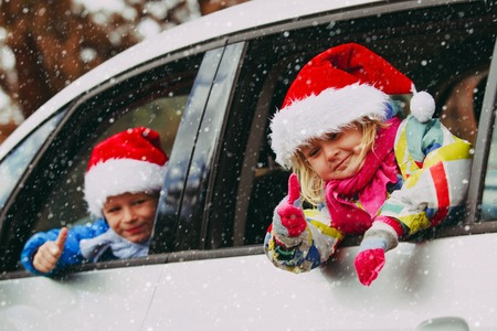 christmas car travel- happy kids travel in winter