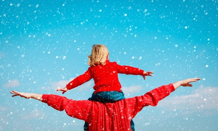cute guy: father and little daughter play at winter sky Stock Photo