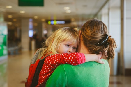 mother hugging little daughter before leaving on long trip Reklamní fotografie