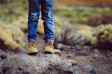 travel concept - little boy hiking boots in mountains Stok Fotoğraf - 87939684