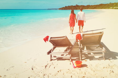 Christmas on beach -chairs and happy couple at sea Stock Photo