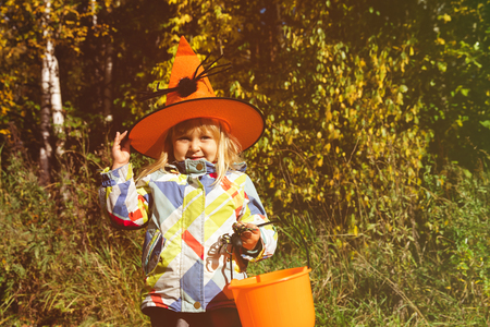 little girl trick or treating in autumn nature Stock Photo