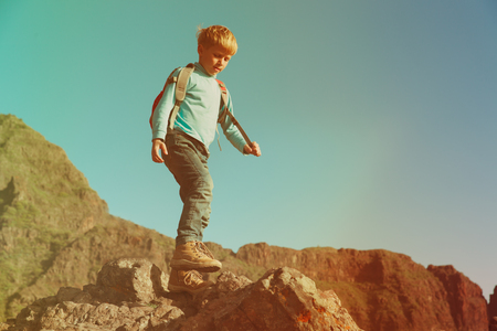 little boy with backpack hiking in mountains Stock fotó - 89193035