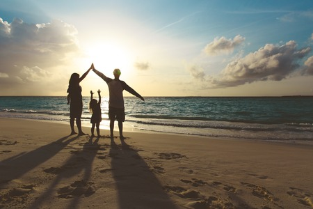 happy family with kids play at sunset beach