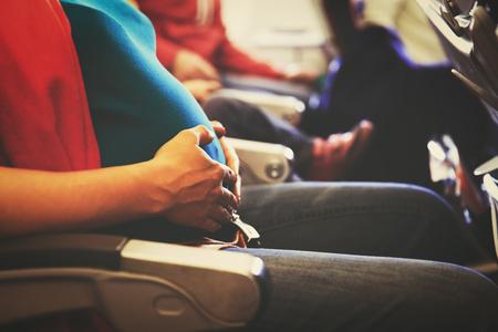 pregnant woman travel by plane