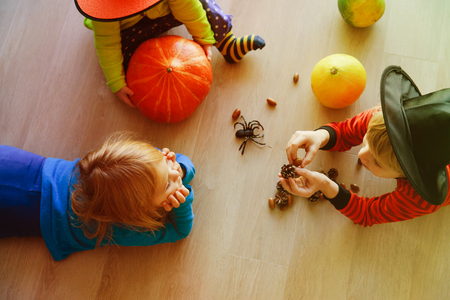 Halloween preparation. Kids making crafts from natural materials Stock Photo