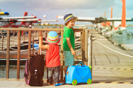 little boy and girl waiting for seaplane, travel concept