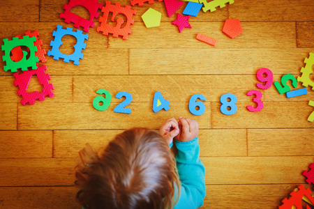 little girl learning numbers, education concept