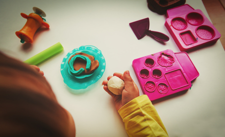 moulding: Child playing with clay molding shapes Stock Photo
