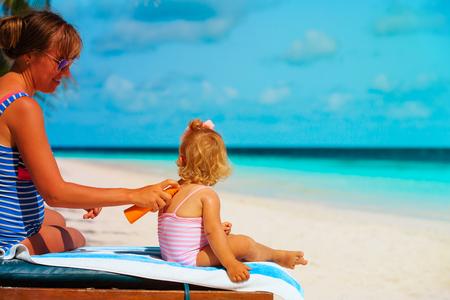 mother applying sunblock cream on little daughter Reklamní fotografie