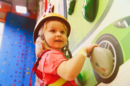 little girl climbing in sport center