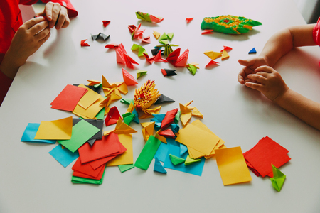 Kids Making Origami Crafts With Paper Stock Photo Picture And