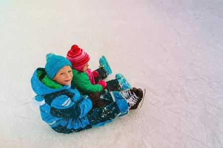 little boy and girl skaing in winter Banco de Imagens