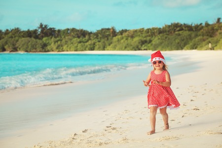 little girl celebrating christmas on tropical beach