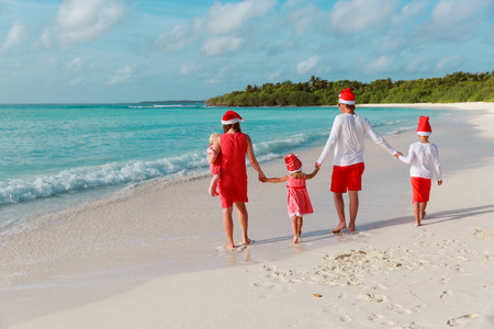 Happy family with kids on tropical Christmas vacation