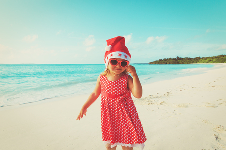 little girl celebrating christmas on tropical beach