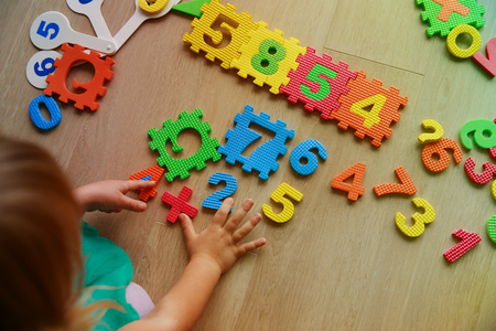 little girl learning numbers and math Stock Photo