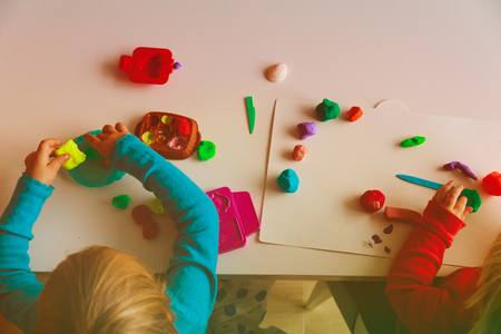 kids play with clay molding shapes Stock Photo