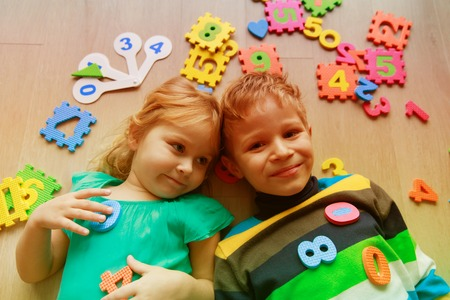 happy little girl and boy learn numbers and shapes Stock Photo