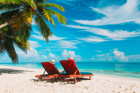 Two beach chairs on tropical vacation