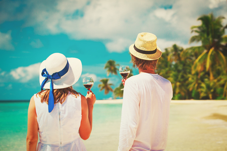 happy loving couple celebration drinking wine at beach Stock Photo