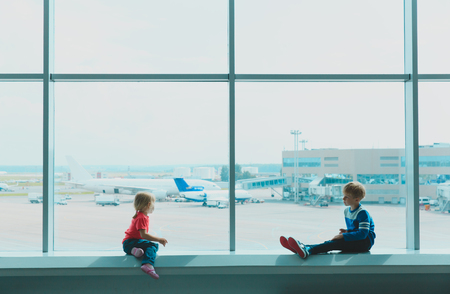 kids waiting for plane in airport Stock Photo