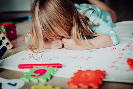 little girl tired of homework, stress and depression Banque d'images - 93599426