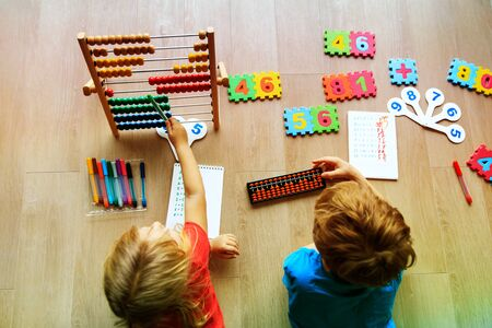 kids learning numbers, mental arithmetic, abacus calculation Banco de Imagens