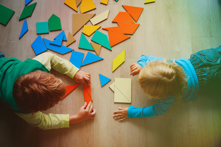 kids playing with puzzle, learn shapes, education concept