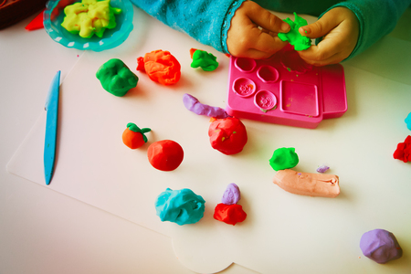 Child playing with clay molding shapes Stok Fotoğraf