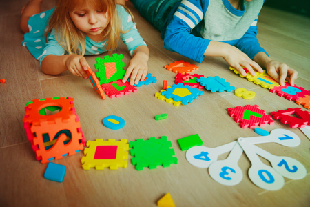 kids learning numbers, calculations, play with puzzle Stock fotó