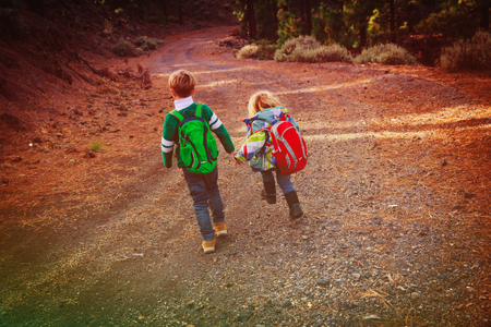 little boy and girl travel hiking in nature