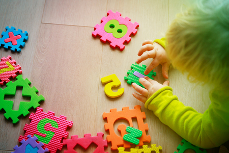 little girl playing with puzzle, early education Stock Photo