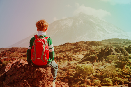 little boy hiking travel in mountains 版權商用圖片