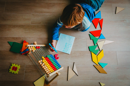 little boy learn to write and calculate numbers